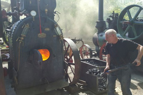 Hollycombe-volunteer-David-Shrub-helping-create-steam-at-Hollycombes-Steam-in-Miniature-Weekend.jpg