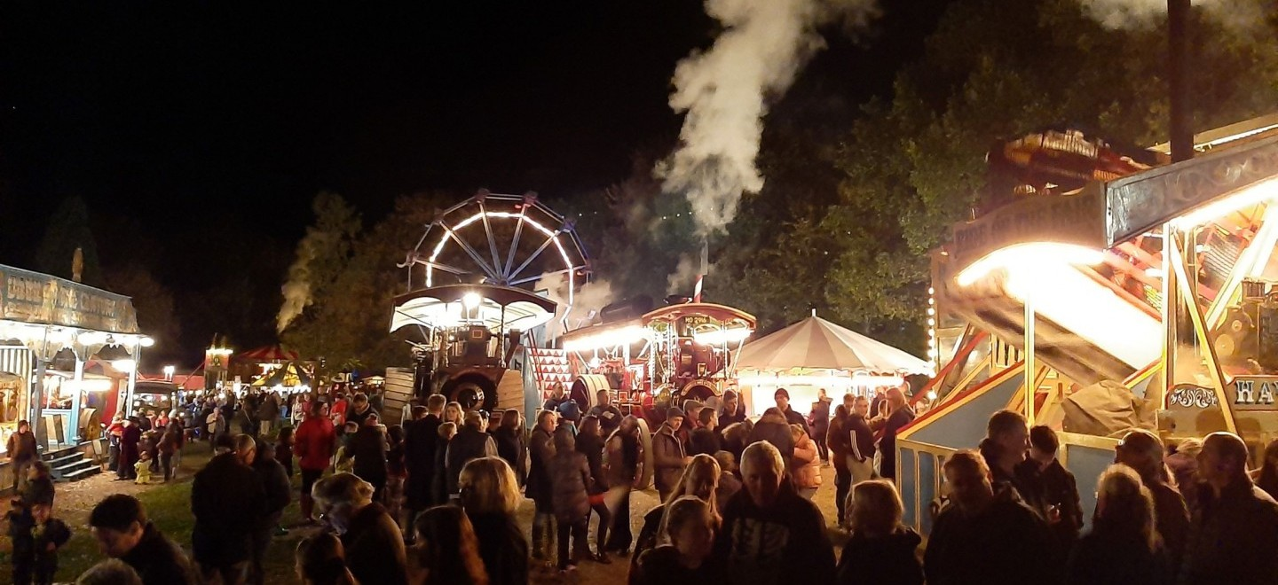 View of the crowd at Hollycombe Fairground at Night